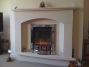 Dimplex Exbury Electric Fire in Portuguese Limestone Fireplace with Lights, Tarleton, Preston, Lancashire