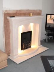 EKO 3030 Gas Fire in Portuguese Limestone Fireplace with Lights 2, Birkdale, Southport, Merseyside