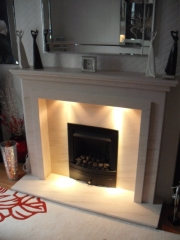 EKO 3030 Gas Fire in Portuguese Limestone Fireplace with Lights, Churchtown, Southport, Merseyside
