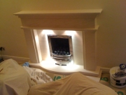 EKO 3030 Gas Fire in Portuguese Limestone Fireplace with Lights, Leyland, Preston, Lancashire