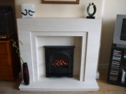 Gazco High Efficiency Gas Fire in Portuguese Limestone Fireplace with Lights, Formby, Merseyside