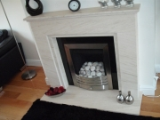 Legend Vantage Gas Fire in Portuguese Limestone Fireplace with Lights, Banks, Southport, Merseyside.